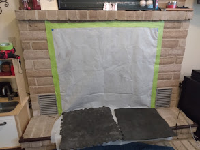 Fireplace opening sealed off with plastic sheeting to prevent creosote from coming into the living room while sweeping the chimney.