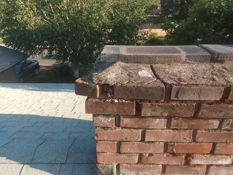 Photo of a chimney with loose brick.