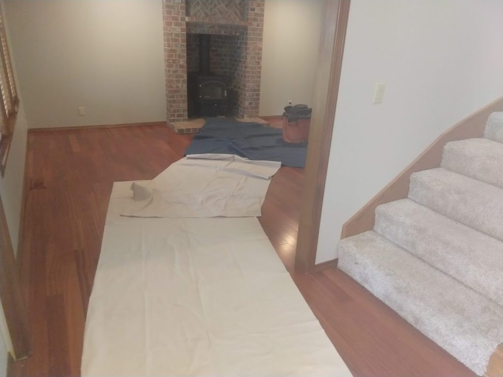Floors-protected-with-carpet-runners-and-movers-blankets